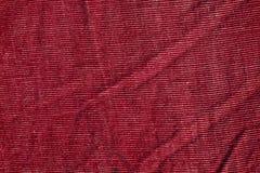 Textiltextur för röd färg Arkivfoto