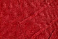Textiltextur för röd färg Arkivbild