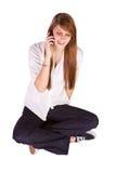 texting美丽的女孩 免版税库存照片