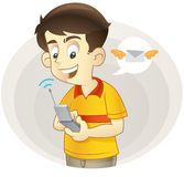 Texting. Smiling kid texting with his cellular phone Royalty Free Stock Photos