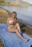 Texting on beach Stock Photo