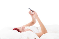 Texting in bed Royalty Free Stock Photography