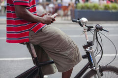 Texting on bicycle Stock Photo