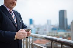Texting businessman Stock Photography