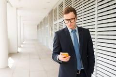 Texting businessman Stock Photo