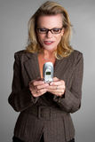 Texting Businesswoman Stock Image