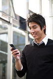 Texting casual asian businessman Royalty Free Stock Photo