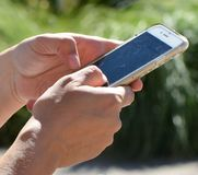 Texting. On a cell phone Royalty Free Stock Photography