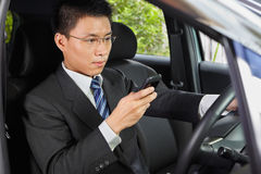 Texting on cell phone while driving Royalty Free Stock Images