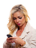 Texting on cell phone. A woman is sending a text message on her cell phone stock images