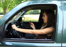 Texting and driving. Teenager texting and driving and getting into an accident Stock Photography