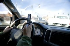 Texting while driving stock images