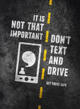 Texting and driving warning. Warning about the dangers of texting and driving over concrete background Royalty Free Stock Images