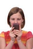 Texting en el teléfono Foto de archivo libre de regalías
