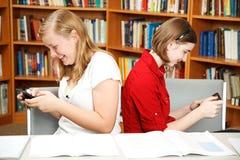 Texting en vez de estudiar Fotografía de archivo