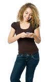 Texting fêmea Imagem de Stock