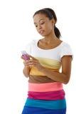 texting för mobil telefon för flicka nätt arkivfoton