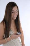 Texting femenino en el teléfono móvil Foto de archivo libre de regalías