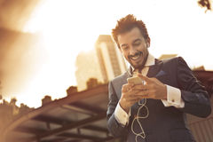 Texting is funny. Business man is texting on his phone Royalty Free Stock Photos