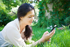 Texting in the Garden Royalty Free Stock Photography