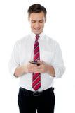Texting Geschäftsperson stockbild