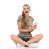 Texting Girl Smiling Stock Photography