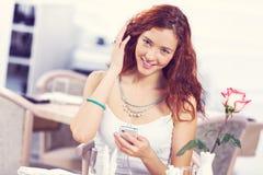 Texting massages at cafe Stock Photos
