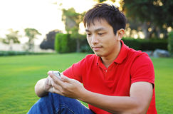 Texting messages on phone Stock Photo