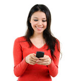 Texting on mobile phone Stock Image