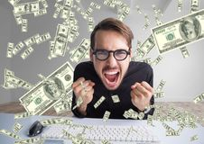 Texting money. very happy man shouting in front of the computer, money everywhere Royalty Free Stock Image