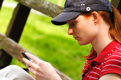 Texting from the Park Stock Photography