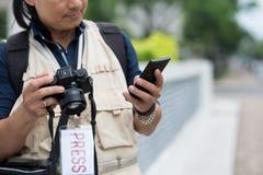 Texting photographer Stock Photo