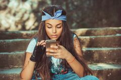 Free Texting, Reading Sms.young Girl At  Park Stock Photography - 178594622