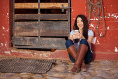Texting at the stables Royalty Free Stock Photography