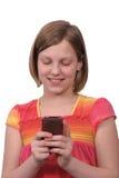 Texting sul telefono fotografia stock
