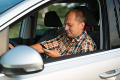 Texting and talking while driving Stock Image