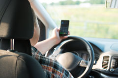 Texting and talking while driving Royalty Free Stock Image