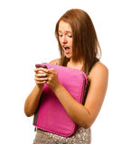 Texting teen schoolgirl reacts with shock Royalty Free Stock Photo