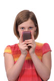 Texting am Telefon Stockbilder
