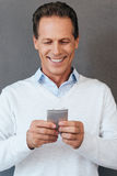 Texting to friend. Stock Images