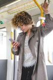Texting on the train Royalty Free Stock Photo