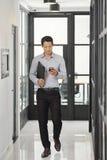 Texting walking businessman royalty free stock image