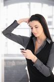 Texting woman posing Stock Photography