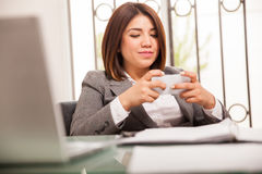 Texting at work hours Royalty Free Stock Photography