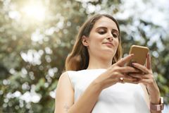 Texting young woman stock image