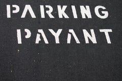 Textlön för att parkera i franskt Arkivfoto