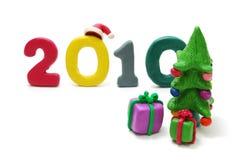 Texto 2010, árvore de Natal e presentes Fotos de Stock