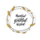 Texto agradecido, bendecido, agradecido en guirnalda brillante del oro del otoño Foto de archivo libre de regalías
