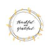 Texto agradecido y agradecido en guirnalda del otoño Fotos de archivo