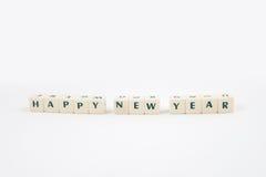 Texto blanco del cubo de la Feliz Año Nuevo Foto de archivo